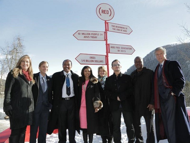 L-R: Deborah Dugan, CEO, (RED); Mark Dybul, Executive Director, The Global Fund to Fight AIDS, TB and Malaria; Patrice and Precious Motsepe; Anne Finucane, Bank of America; Bono, co-founder, (RED); President Mahama, Ghana; Bill McDermott, SAP. (RED) announces $10 million commitment from Bank of America to the Global Fund to fight AIDS, attracting matching funds from the Gates Foundation, SAP and the Motsepe family.  (RED) passes milestone of $250 million for the Global Fund.   (PRNewsFoto/(RED))